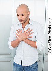 Casual young man with chest pain at
