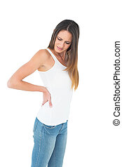 Casual young woman suffering from back pain