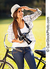 casual young woman with camera outdoors