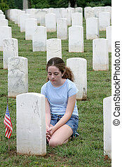 Casualties of War - a young girl mourning a fallen soldier...