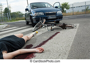 Casualty in blood on the road - A dead female cyclist and a...