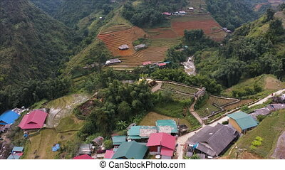 Cat Ba Village, South of Sapa in the Northern Mountains of Vietnam. Aerial footage recorded on a drone in October 2019