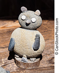 cat doll made of boulders