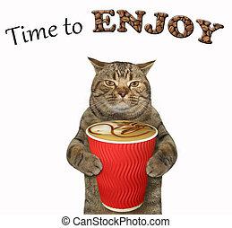 Cat drinks black coffee