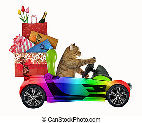 The cat in the Santa Claus hat drives a car with Christmas toys. White background.