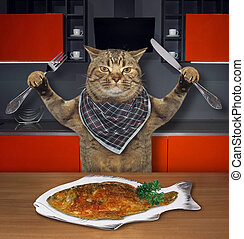 Cat eats fish in the kitchen 2