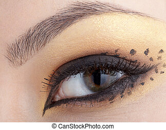 cat girl - close-up of eyes with make-up in leopard style