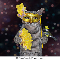 Cat gray in yellow carnival mask 2