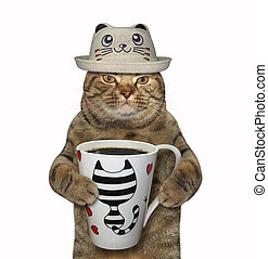 Cat in a funny hat with coffee