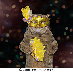 Cat in a yellow masquerade mask