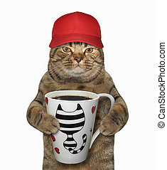 Cat in cap holds a cup with coffee