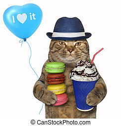 Cat in hat with coffee and biscuits