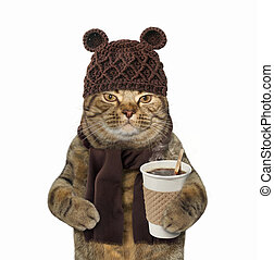 Cat in knitted hat with coffee