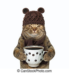Cat in woolly hat with coffee