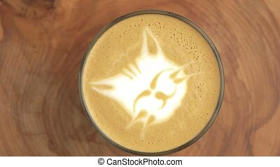 Cat latte art. Close up of coffee foam.