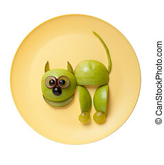 Cat made of apple on yellow plate