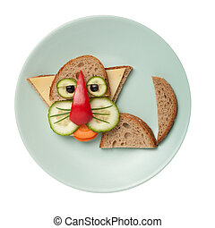Cat made of bread on olive plate