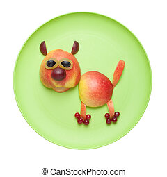 Cat made of fruits on green plate