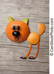 Cat made with orange on wooden background