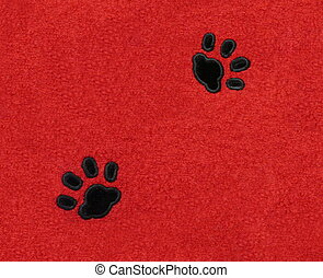 Cat Pawprints on Fabric - Two black velvet pawprints of a...