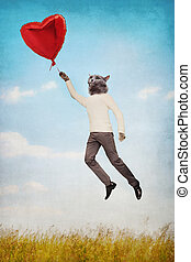 Cat people flying holding a balloon in the shape of heart