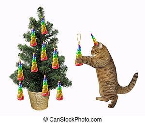 Cat unicorn decorates the Christmas tree