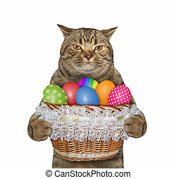 Cat with basket of easter eggs