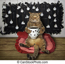 Cat with cup of coffee on lounger