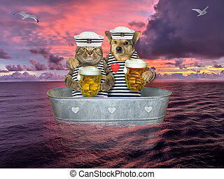 Cat with dog drinks beer in washtub