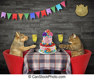 Cat with dog eat cake in restaurant