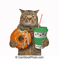Cat with green cup of coffee