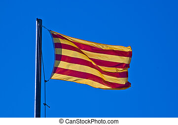 Catalan flag - La senera, the catalan flag, in front of blue...