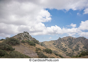 Scenic view of rugged mountains and white clouds in the back country of Santa Catalina Island