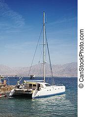Catamaran in marina - Sailboat (catamaran) in a marina in ...
