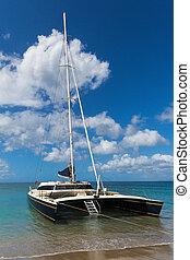 Catamaran off the coast of St Nevis near St Kitts in the Caribbean