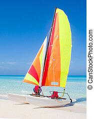 Catamaran on a beautiful beach in the caribbean.