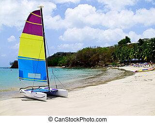 Catamaran on beach - Catamaran on tropical beach on a clear ...