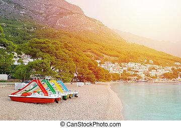 catamaran on the beach in Brela, Croatia