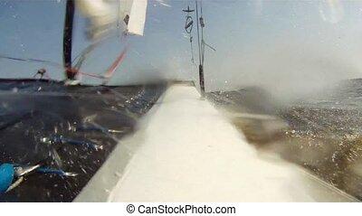Catamaran sailing - Sailing onboard a catamaran, seen from...