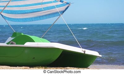 Catamaran standing on the sandy beach. Slow motion....