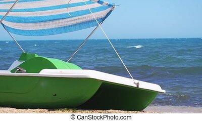 Catamaran standing on the sandy beach. Slow motion....