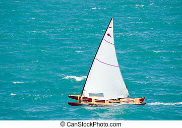 Catamaran - Yellow catamaran sailing on a tranquil turquoise...