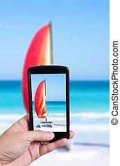 Catamaran with its colorful sails wide open on cayo Santa Maria Cuban white sandy beach
