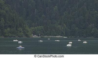 Catamarans floating on alpine lake in Abkhazia mountain -...