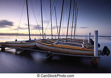 Catamarans moored at Long Jetty, Australia