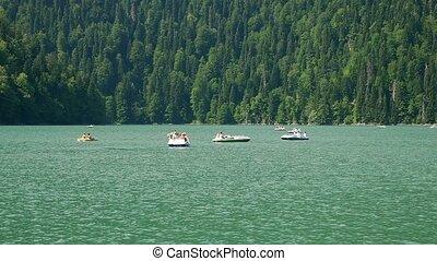 catamarans on the mountain lake Ritsa, Abkhazia