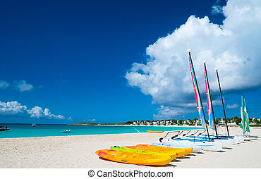 Catamarans on tropical beach - Catamarans on a beautiful ...