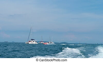 Catamarans, yachts and speedboats in Andaman sea - view from...