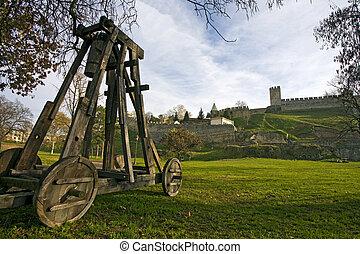 Catapult under city wall