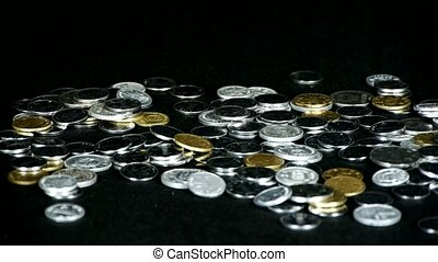 catch a group of coins by hand.